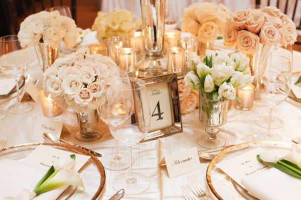 Peach, peach, peach reception flowers in this lovely centerpiece