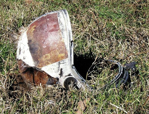 Helmet that one of the Columbia astronauts was wearing during reentry. A Texas farmer found it in his field shortly after seeing the shuttle break apart in the sky - Imgur