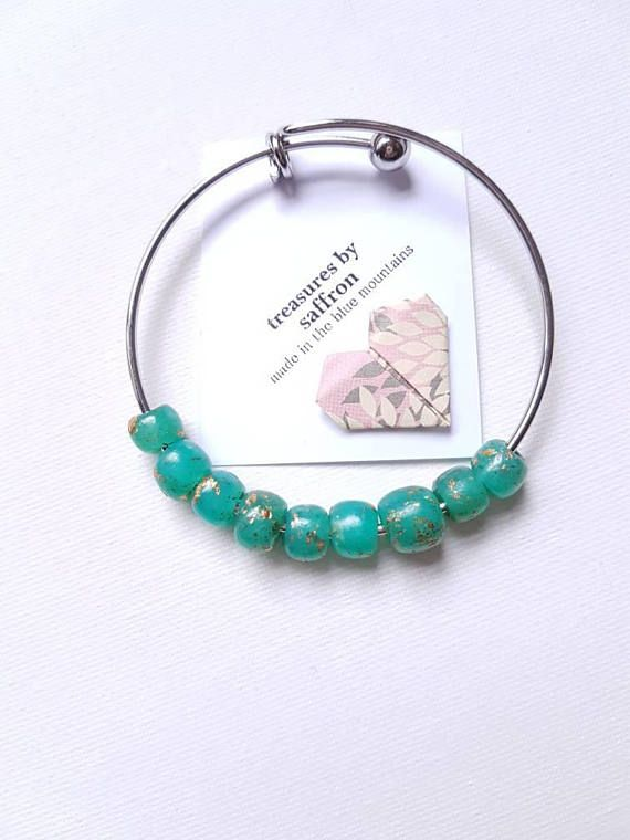 Check out this item in my Etsy shop https://www.etsy.com/au/listing/590926647/beaded-bangle-aqua-bracelet-handmade