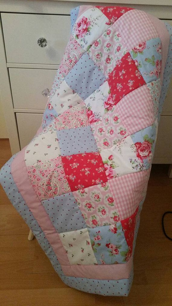 This Vintage Style Baby quilt is handmade from a selection of 100% cotton fabrics including many by the fantastic Cath Kidston. Beautiful Pinks, Blues, White, Greens and a splash of Red have been teamed together giving a vintage style.  Backed with a Snow white 100 percent cotton fabric and quilted with a 4oz Hypoallergenic Wadding. Makes a lovely gift for a new baby or your special little Princess to top or have as a runner or throw on her bed or chair. Also suitable as a playmat for tummy…