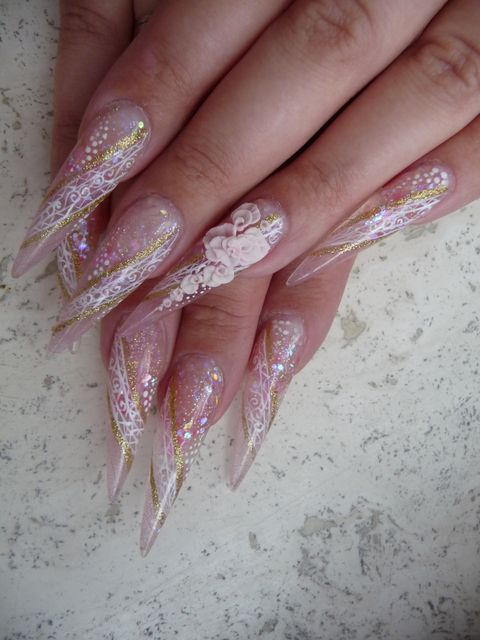 Bridal stiletto nail design with lace and 3D nail art
