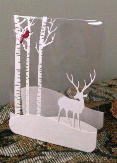 By jmrypstra at Splitcoaststampers. Die-cut trees, bird, and deer on acetate. Dies from Impression Obsession.