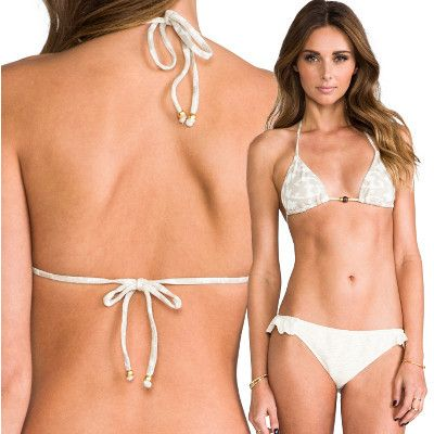 The Eberjey Hidden Cove Gisele Triangle Top always fits just right. The Gisele Top gets the classic string bikini look right with it's bohemian bead detail in the front, and matte gold beads dangling from the strings in the back.  The inspiration behind the Hidden Cove Collection by Eberjey is the feeling you would get from finding a hidden cove with the one you love.   - Ties in the back with matte gold beads - Removable bra pads  #eberjey #bikinitop #bikini