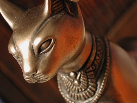 Bast (aka Bastet) : in the first millennium BC, when domesticated cats were popularly kept as pets, Bastet began to be represented as a woman with the head of a cat and ultimately emerged as the Egyptian cat-goddess