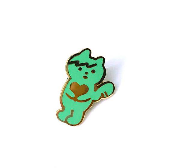 Minty green cat angel baby enamel pin