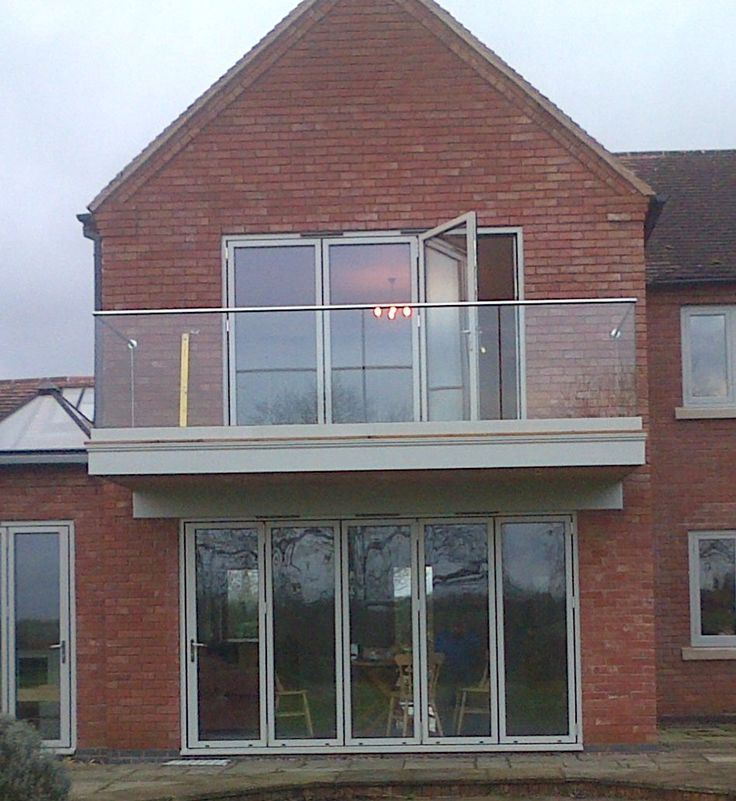 Walk on balcony with frameless glass balustrade.  Supplied by Morris Fabrications Ltd.