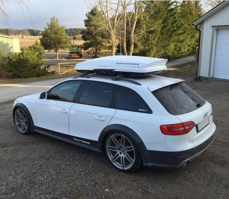 White Audi Allroad with rooftop carrier