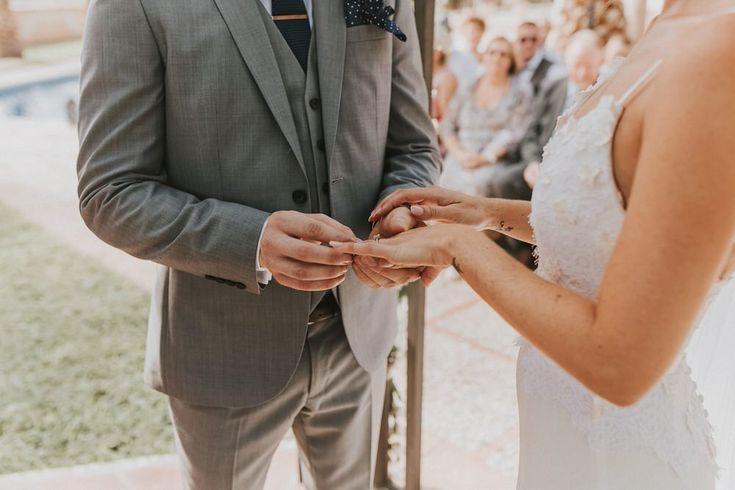Couples exchanging their rings