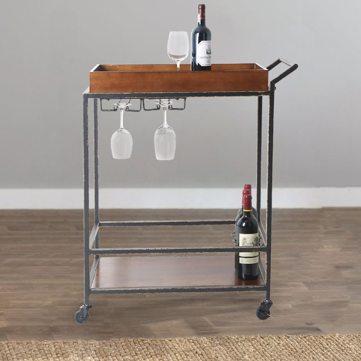 Add a classy touch to your living room, dining room or other entertainment area with this two-tier antique finish wood tube bar cart. #TidyLiving #BarCart #Antique #Wood #Entertain #Wine #Champagne #Glasses