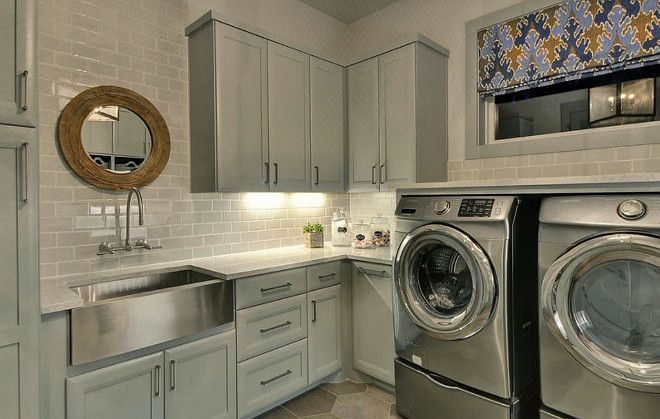 Gray Laundry Room Cabinet paint Color. Gray Laundry Room Cabinet with stainless steel farmhouse sink. Gray Laundry Room Cabinet Paint color ideas. #GrayLaundryRoom #Cabinet #PaintColor Geschke Group Architecture.