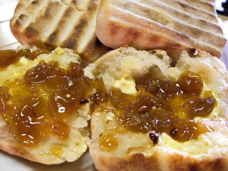 Roosterkoek (homemade bread dough) baked on a grill goes well with korrelkonfyt (grape jam).... and potjiekos or braaivleis (barbeque)