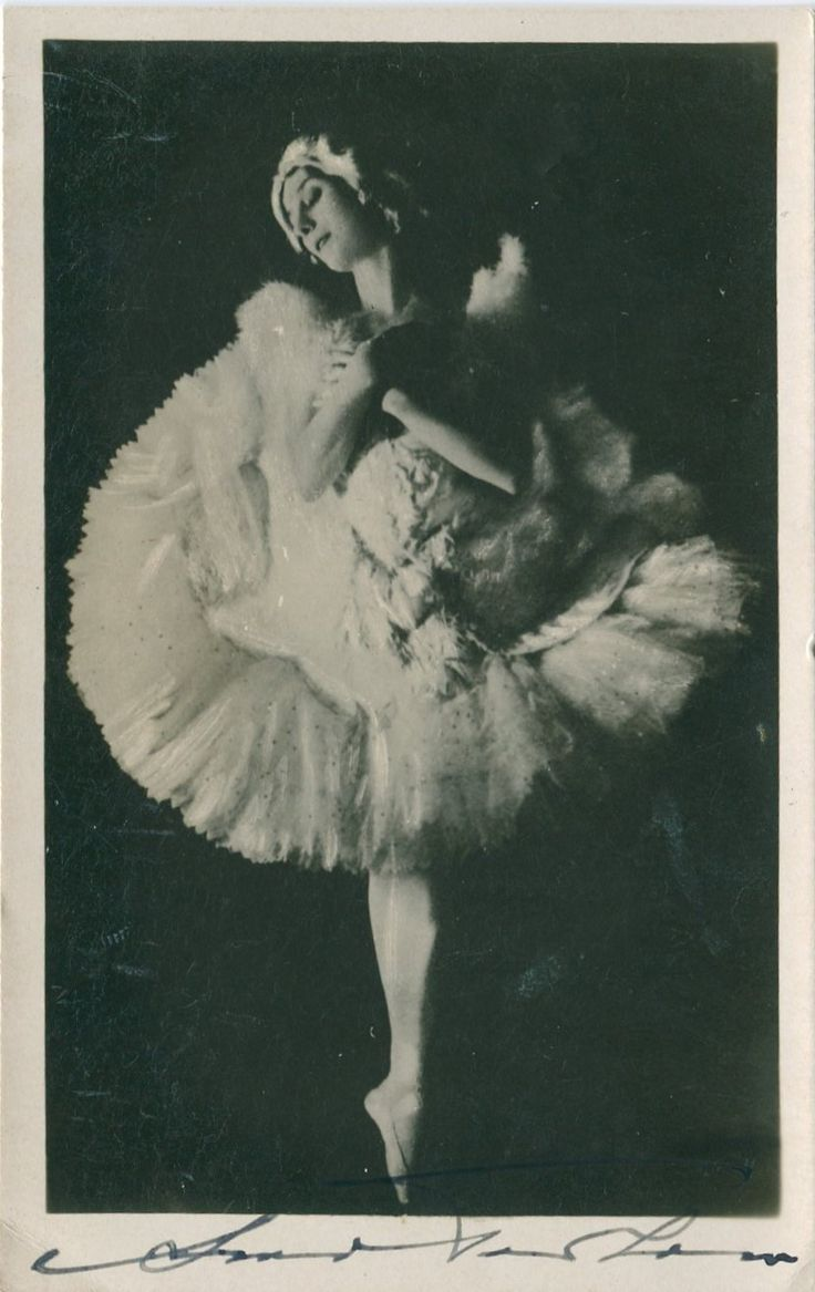 PAVLOVA ANNA: (1881-1931) Russian Ballet Dancer. Vintage signed postcard photograph of Pavlova standing in a full length pose, in costume, en pointe. Signed ('Anna Pavlova') in black fountain pen ink with her name alone to the lower white border.