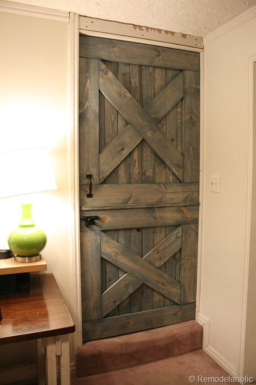 Dutch Door DIY Pet Door ~ I want this as my mud room's interior door & maybe use heavy duty chicken wire instead of the panels behind the bottom X? Then the dogs can still watch but not be bothersome to guests.