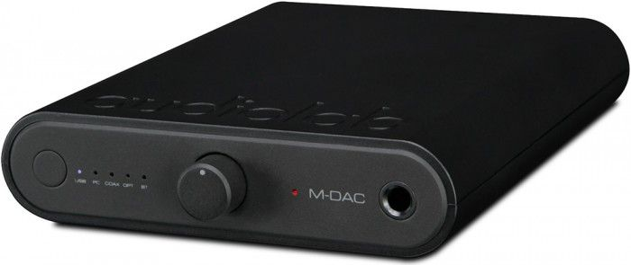 The Audiolab M-DAC Mini is the smallest high-resolution in Audiolab's range, the M-DAC Mini furthers the success of the M-ONE range. Blurring the lines between home hi-fi DACs and small, portable DAC units, the M-DAC Mini is ideally sized to sit both neatly on a desk or table, and within the pocket of your jacket. Front.