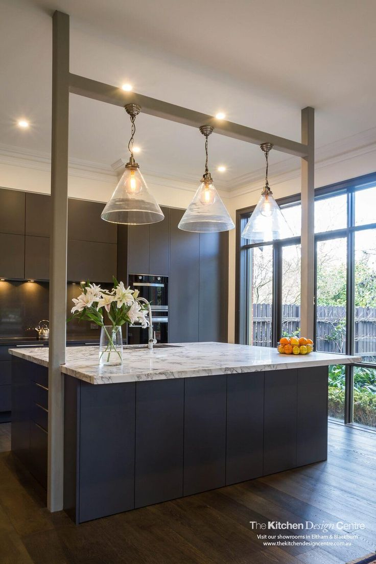 A semi-industrial meets eclectic kitchen, lounge room and bathroom. Dark cabinetry with a marble benchtop. www.thekitchendesigncentre.com.au @thekitchen_designcentre