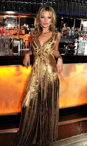 Kate Moss in vintage gold dress at the Marc Jacobs hosted Kate Moss book launch