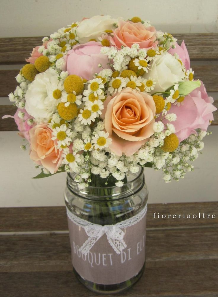Fioreria Oltre/ Bridal bouquet/ Roses, peonies, baby's breath, billy balls, lisianthus, chamomile