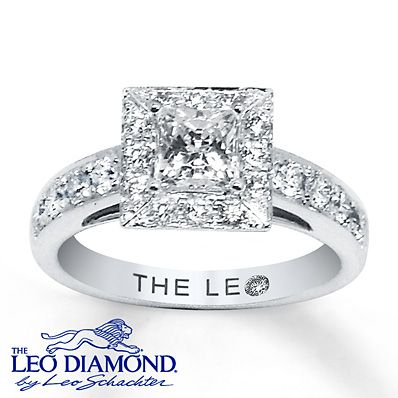 A princess-cut Leo diamond is the scintillating center of this sensational diamond engagement ring for her. Brilliant round Leo diamonds frame the center and line either side of the 14K white gold band. The ring has a total diamond weight of 1 1/3 carat. Independently Certified and laser-inscribed with a unique Gemscribe® serial number.