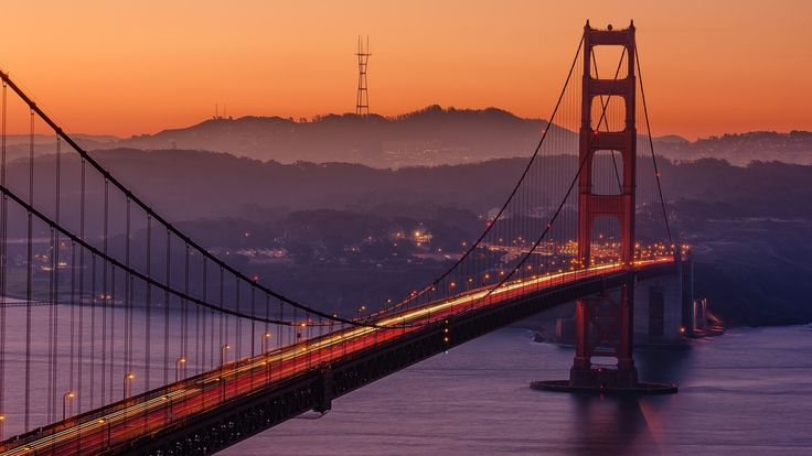 Golden Gate Bridge is a suspension bridge spanning the Golden Gate strait, the one-mile-wide (1.6 km), three-mile-long (4.8 km) channel between San Francisco Bay and the Pacific Ocean.