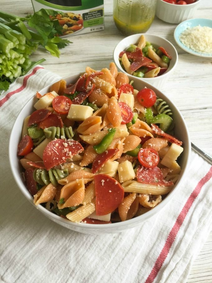 Pizza Pasta Salad is a lightened up pasta salad using turkey pepperoni, vegetable pasta, fresh mozzarella cheese, vegetables and a homemade Italian dressing.  // A Cedar Spoon #ad