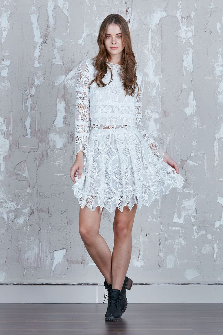 New Womenswear Brand Alilia - It's a white essential for your wardrobe, except this one's got saturated thread works of floral artwork running through the shoulder and sleeves and lace details to accentuate