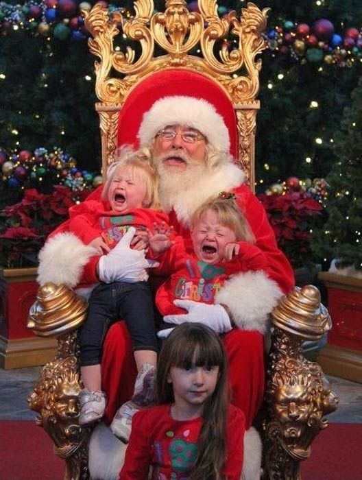 """Older Sis is thinking, """"I can't believe I waited in that long line for THIS! """"(Community Post: 40 Images Of Santa And Crying Kids)"""