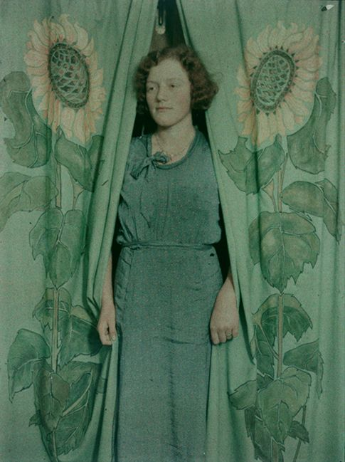 Woman with sunflower print curtains, 1900-1930, New Zealand, by James Chapman-Taylor. Autochrome