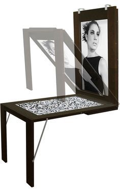 Fold-down wall mounted table turns into a picture frame. Ikea should do one for kids so they can do art on the table and then slip their creations right into the frame. [only]1,440 Euros