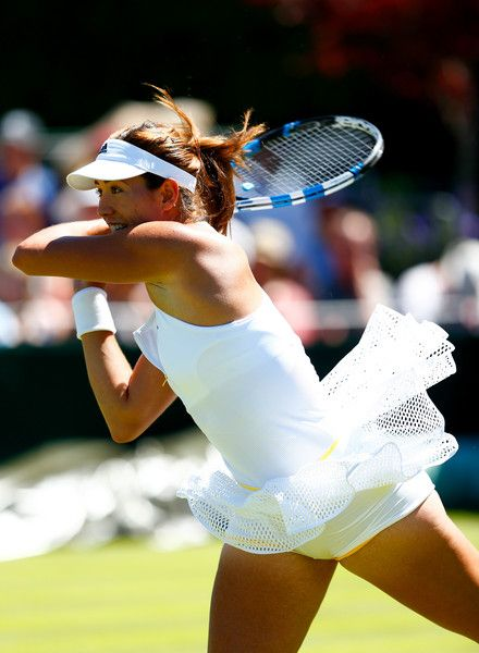 Garbine Muguruza Photos Photos - Garbine Muguruza of Spain plays a forehand in her Ladies' Singles Fourth Round match against Caroline Wozniacki of Denmark during day seven of the Wimbledon Lawn Tennis Championships at the All England Lawn Tennis and Croquet Club on July 6, 2015 in London, England. - Day Seven: The Championships - Wimbledon 2015