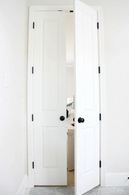 oil rubbed bronze door hinges installed, black hinges on white doors, double bathroom doors, switching out door hinges