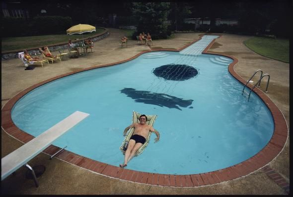 Picture of Country music star Webb Pierce poses in his guitar-shaped pool