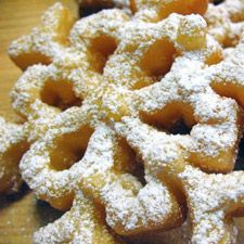 "Simple Rosettes via King Arthur Flour- ""Rosettes are the beauty queen cousin to the homespun funnel cake. Egg rich batter is deep fried on a special decorative iron to crisp, golden perfection. Adorned with a simple coating of sugar, or filled with luscious mousse, they make a unique dessert for any occasion."""