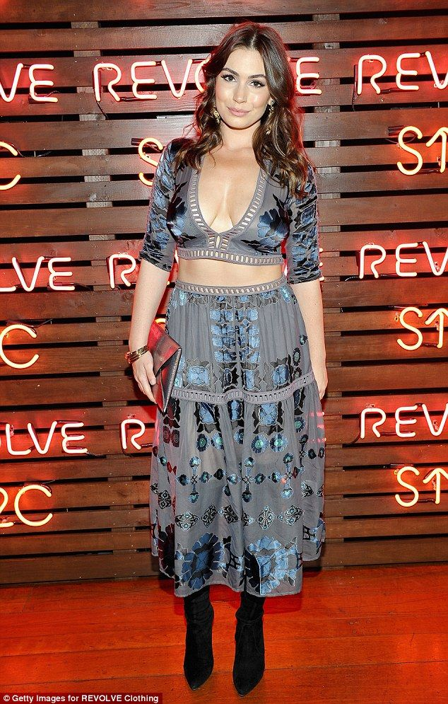 Kiss off: Sophie Tweed-Simmons flashed both cleavage and midriff in a two-piece skirt and top, finished with a pair of black knee-high boots
