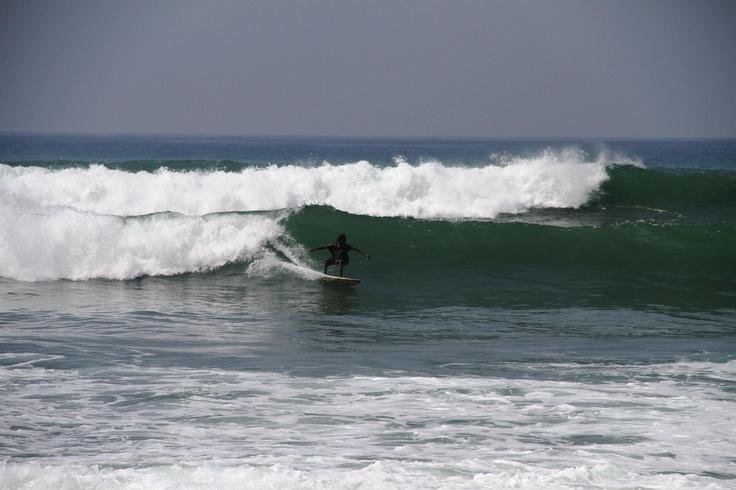 Guy surfing in Sri Lanka