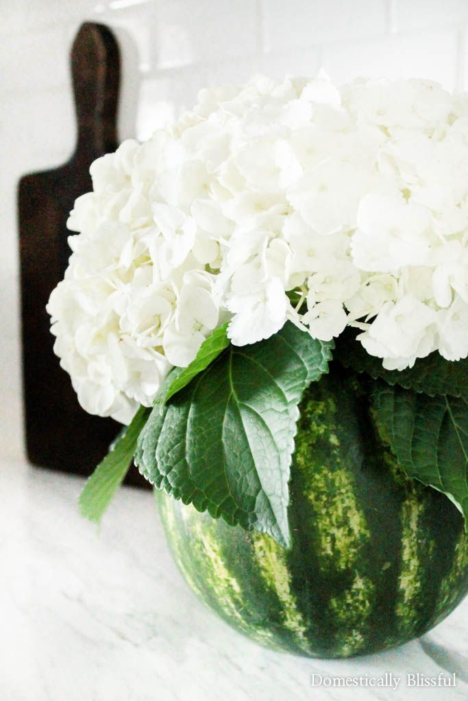 Create your own Floral Watermelon Vase for your home or summer party! Plus unique recipes for leftover watermelon! | flowers | bouquet | centerpiece | tablescape | table decor | summer centerpiece | summer parties | fruit centerpiece | fruit display | fruit vase | summer floral arrangement | 4th of July |