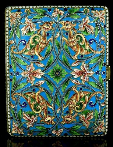 A VERY FINE antique Russian silver and shaded cloisonne enamel cigarette case, made in Moscow between 1908 and 1917, enameled in Medieval Russian style with four pairs of stylized birds and scrolling floral designs against turquoise ground.