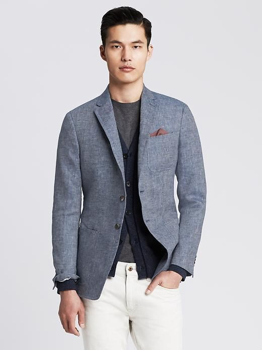Something as simple as teaming a grey linen coat with white jeans can potentially set you apart from the crowd.   Shop this look on Lookastic: https://lookastic.com/men/looks/blazer-cardigan-crew-neck-t-shirt-jeans-pocket-square/10750   — Charcoal Crew-neck T-shirt  — Burgundy Pocket Square  — Navy Cardigan  — Grey Linen Blazer  — White Jeans