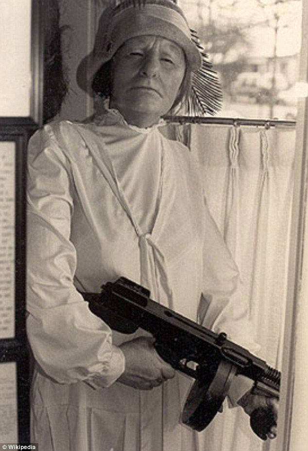 "Kate 'Ma' Barker (born Arizona Donnie Clark; October 8, 1873 – January 16, 1935) was the mother of several criminals who ran the Barker gang from the 'public enemy era', when the exploits of gangs of criminals in the U.S. Midwest gripped the American people and press."" Pictured her with her Thompson gun in an undated picture of the legendary matriarch."