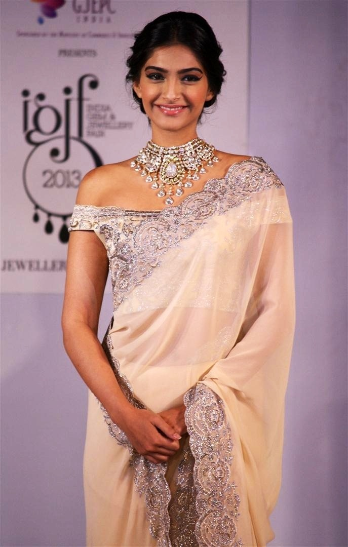 sonam kapoor in stunning white sari with sexy silver off-the-shoulder blouse and silver border, and radiant silver necklace The blouse style is so great paired with the necklace