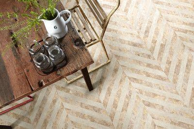 Stone effect herringbone floor using Camaro luxury vinyl tiles in Crema Slate and White Metalstone