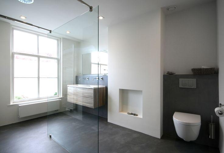 Master bathroom.  Project summary: A complete makeover of a delapitated 19th century city house in the 'Zeehelden'-quarter in The Hague (NL). More information: http://www.foamarchitecten.nl/werk/50/woning-zeeheldenkwartier