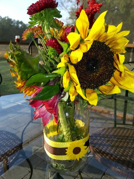 Sunflower mason jar centerpieces for birthday celebration
