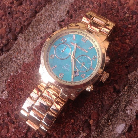 Michael Kors Gold & Turquoise Blue World Watch Lightly worn. Gold with turquoise blue world face. Does come with extra links. Needs a new battery. Michael Kors Accessories Watches