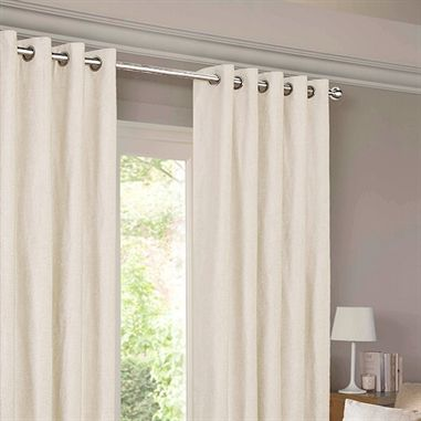 Cream curtains with chrome grommets