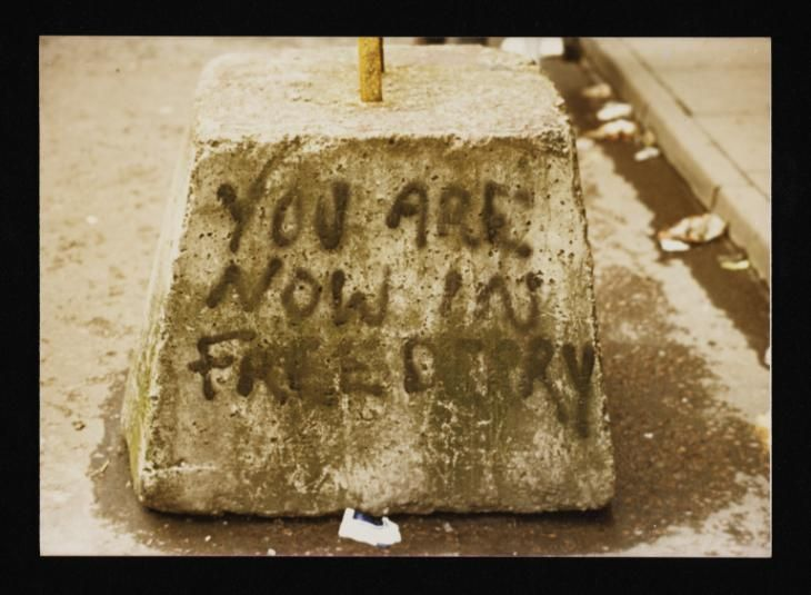 Conrad Atkinson 'Colour photograph of a stone painted with the words, 'You Are Now In Free Derry'', [c.1974–5] © Conrad Atkinson