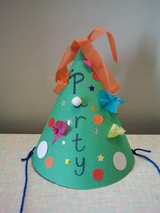 """Make paper party hats after reading """"If you give a pig a party"""" by Laura Numeroff."""
