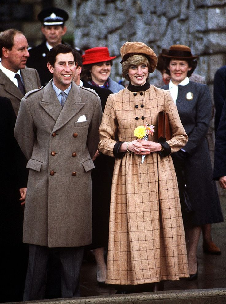 The Prince and Princess visit Wales, Diana wearing a suede beret by John Boyd and a coatdress by Arabella Pollen. via StyleList
