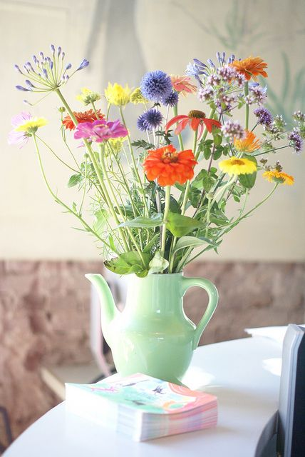wild and delicate. basically picture perfect. Love that they are placed in a tea pot. |Pinned from PinTo for iPad|