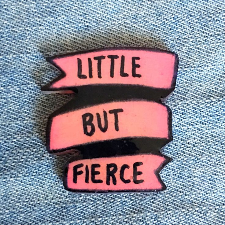 "This is a cute pink banner pin with the quote, ""Little But Fierce"". It is the perfect spunky pin to go on your jacket, beanie, or bag! Each brooch is made to order and handcrafted. ♥︎ Two secure butte"