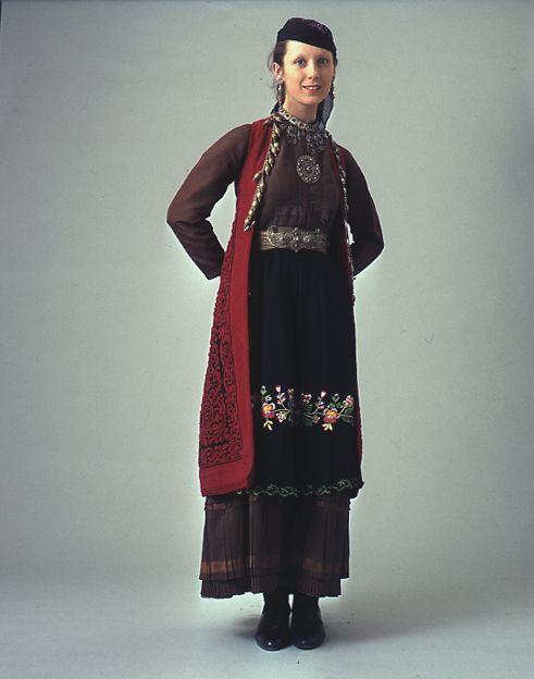 "Early 20th c. woman's costume from the Zagori villages group. The oldest part of the costume is the sleeveless long coat known as ""flokata"" with a complicated red cord embroidery.  Size 	  Date 	Early 20th c."